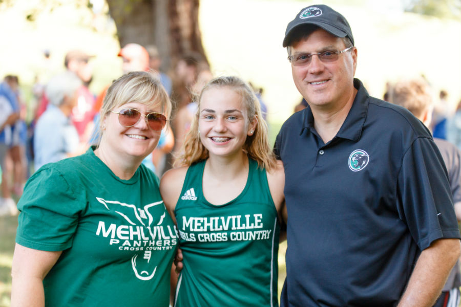 Photo courtesy of Stephanie Lowry || Emma and her family pose for a quick photo during a track meet.