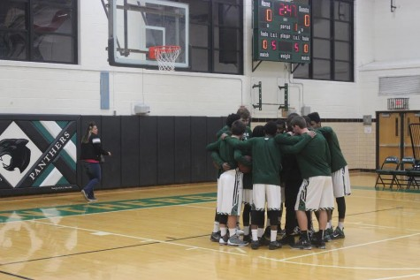 The team huddles before a Dec. 18 win against Windsor.