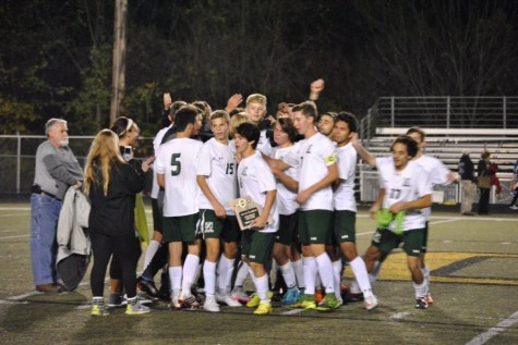 The 2015 boys soccer team celebrates after winning the District Championship, 1-0 over Lindbergh. Senior, Chase Guerrero hold the plaque. Photo Courtesy of: Mehlville Soccer Twitter