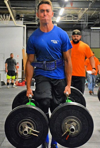 Benson is lifting  400lbs while doing the  farmers walk, during an event he took second in.