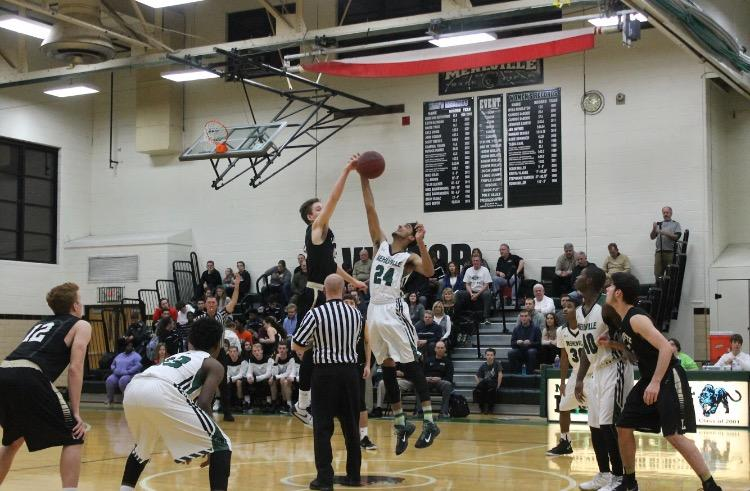 Jan. 8 - Senior, Colby Maynard leaps up for the opening tip-off against Lafayette.