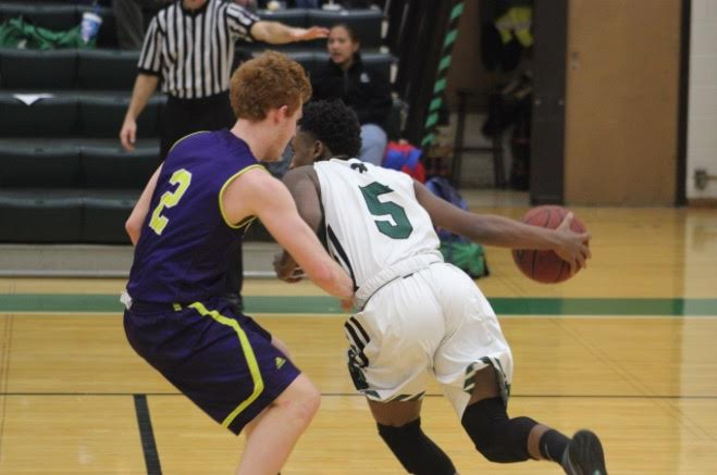 Doron Adams drives to the hoop in the second half of a 69-59 home loss against Eureka.