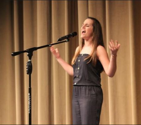 Grace Robertson wows the crowd with her singing performance of