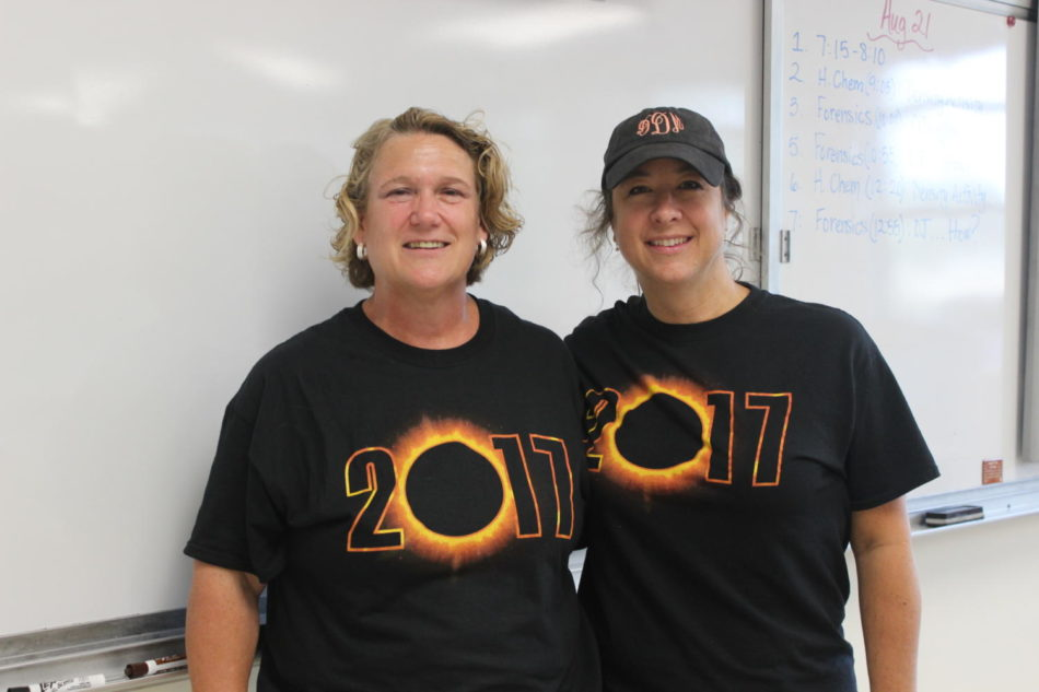 Ms. Drew and Ms. Fritz rock their Mehlville Eclipse 2017 shirts.