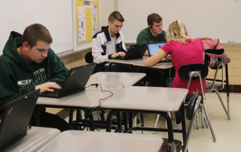 Students in Scott Vouga's World History class engage in class work.