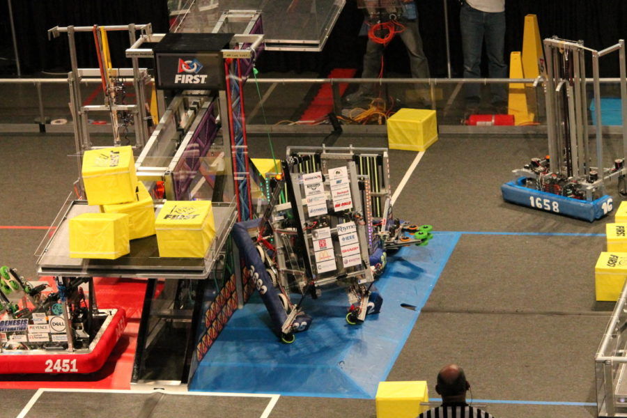 Robots+fighting+in+the+FIRST+Robotics+arena+