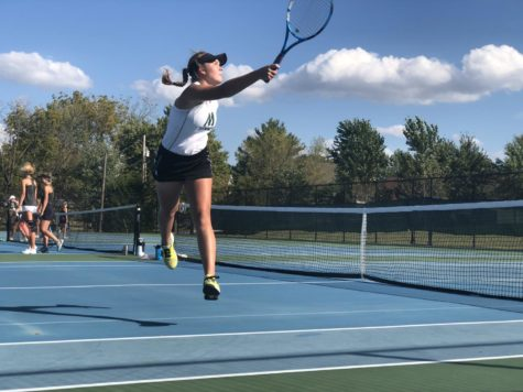 Piskulic plays singles at district finals against Oakville by Erionnia Garner