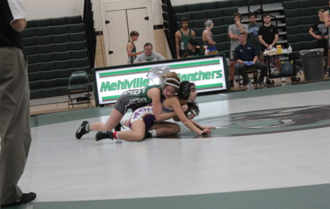 Pesselato (Green) and Alnamoora (Purple) wrestling in scrimmage.  Photo by Kyle Becherer