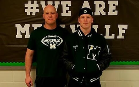 Coach Heinemann, left, and Tyler Hemmelgarn, right at Spring signing day