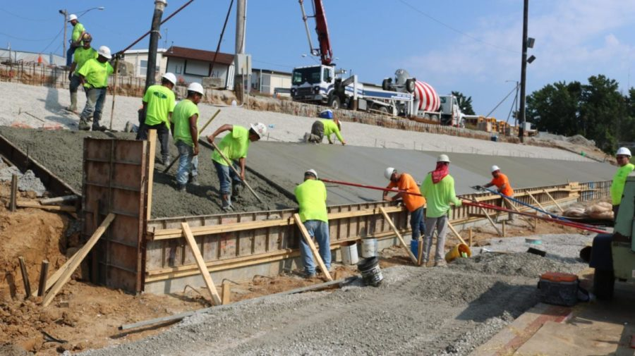 Delays in obtaining permits cause construction delay on stadium bleachers.