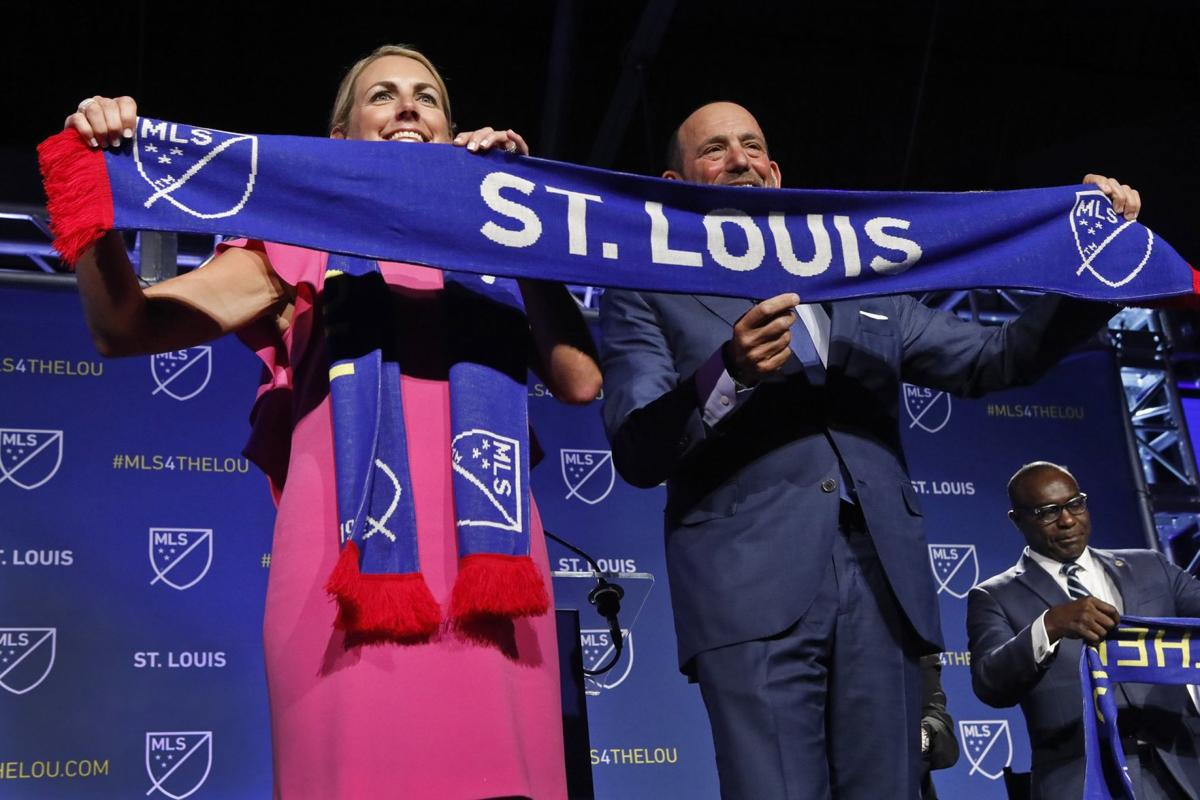 Photo By STL Post Dispatch Carolyn Kindle Betz, President of Enterprise Holdings Foundation, and Don Garber, Commissioner of MLS