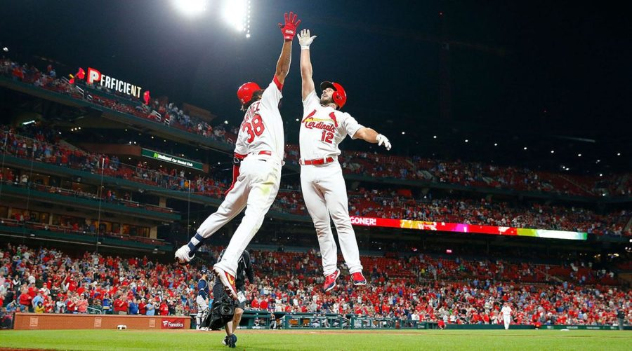 photo+courtesy+of%3A+Sports+illustrated%2C+Paul+Dejong+jumping+to+celebrate+with+Jose+Martinez+