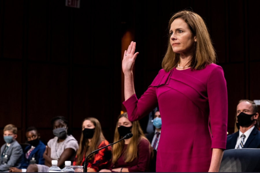 Amy Coney Barrett is sworn in to her confirmation hearing on Capitol Hill.