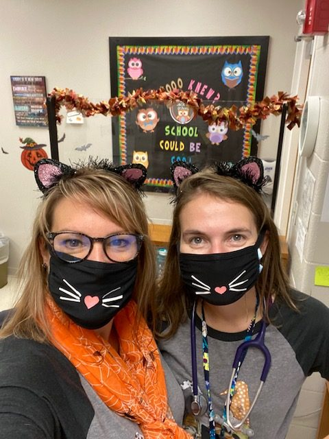Kathy Eisele and Madison Siman take a selfie in the nurse's office.