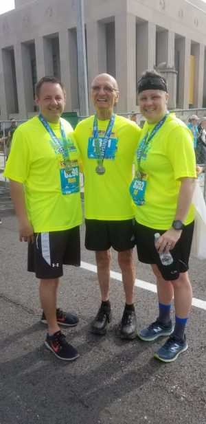 Students on the Go half marathon. Dr. Siebel (middle) pictured with Matt Phoenix (left) and Jill Wojewuczki (right).