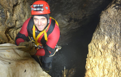 Dan Lamping is pictured using a rope to enter Devils Well, a sinkhole  cave in the state of Missouri.