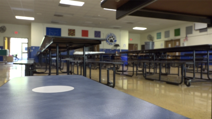 School cafeterias have designated seating to make sure students keep distance while eating.