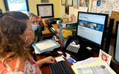Counselor Beth Neighbors helps a student with the college process.