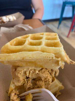 Customer enjoys a waffle ice cream sandwich.