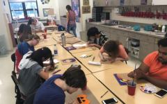 Art Club members create projects after school.